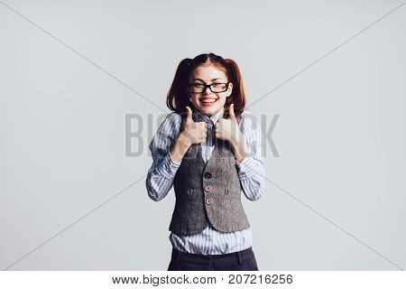 joyful girl with glasses and with tails, isolated