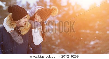 Playful Smiling Couple Walking In Winter Forest. Copyspace