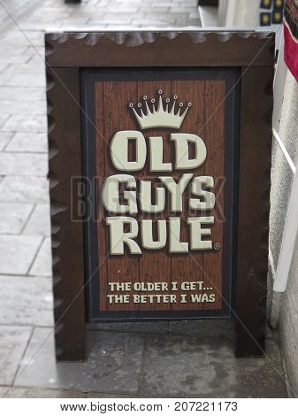 Gibraltar - February 6 2016: Wooden A board outside pub in Gibraltar City centre