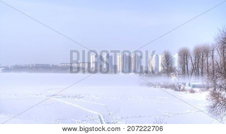 Minsk. Winter. Winter fog over the river Svislach