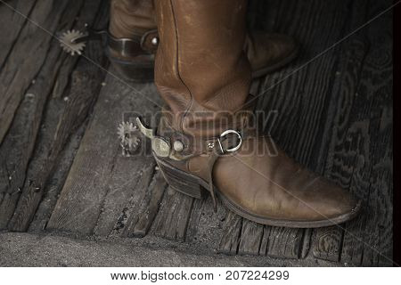 brown, worn leather cowboy boots with spurs