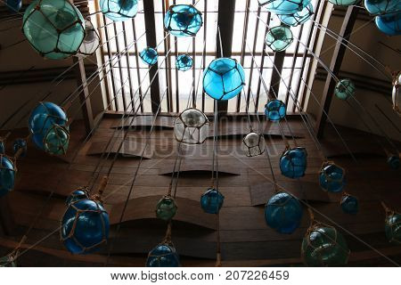 Decoration of ceiling. Blue marble glass tied rope hanging on ceiling.