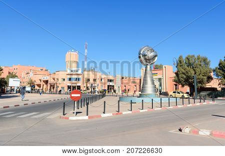 View Of The City. Monument Near Building Of Municipality In Ouarzazate