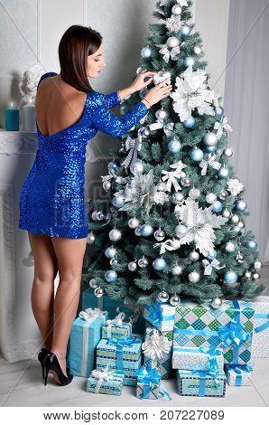 Young Girl Dresses Up Christmas Tree