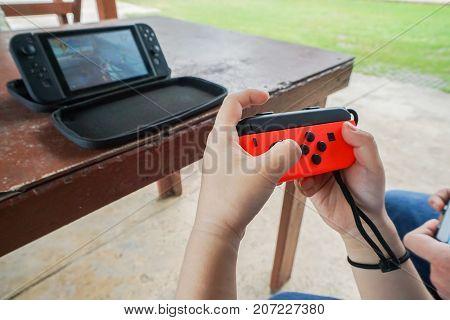 close up kid hold Nintendo switch joystick playing game taken in Bangkok Thailand on 16 July 2017