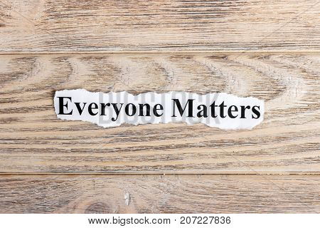 Everyone Matters text on paper. Word Everyone Matters on torn paper. Concept Image.
