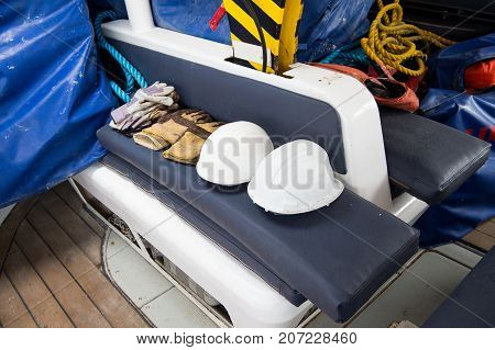 Gloves and helmets on grey seat background in boca de valeria brazil. Construction industry professional workwear and equipment. Safety and protection concept.