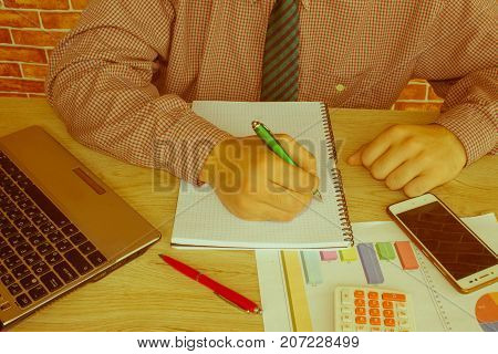 Businessman using a calculator to calculate the numbers. Accounting Accountancy Calculation Concept. Male using a tablet to analysis marketing - Retro color