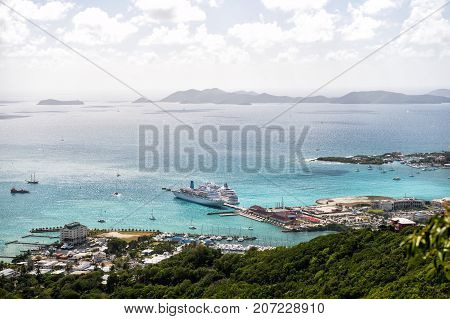 Sea view from mountain in Road Town UK. Blue seascape with yachts ships islands on cloudy sky background. Summer vacation concept. Adventure and discovery. Travel destination and wanderlust