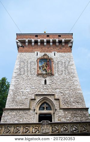 Stone tower on blue sky background in Krakow Poland. Landmark and sightseeing. Fortification protection and safety concept