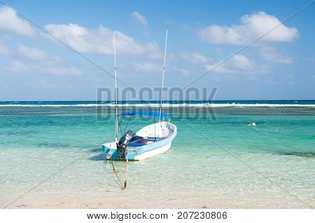 Boat In Sea On Blue Sky Background In Costa Maya, Mexico