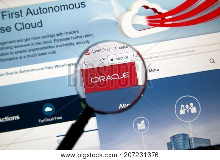 MONTREAL CANADA - OCTOBER 2 2017: Oracle home page under magnifying glass. Oracle is one of the largest vendors in the enterprise IT market.