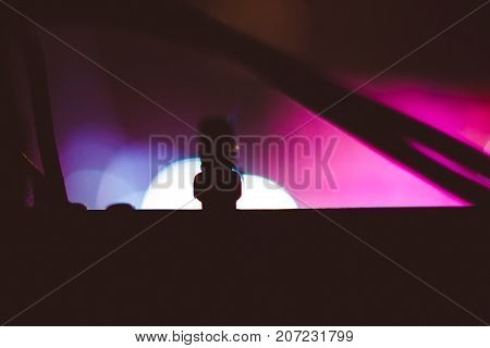 Stage lights on concert. Lighting equipment with multicolored beams.