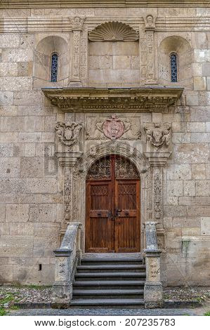 Part of the wall with a lateral entrance to the Saint Michael Roman Catholic Cathedral in Carolina White Fortress of Alba Iulia City Romania.