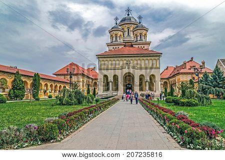 ALBA IULIA ROMANIA - APRIL 30 2017: View in inner yard of Coronation (Reunification) Cathedral from Alba Iulia city Transylvania Romania.