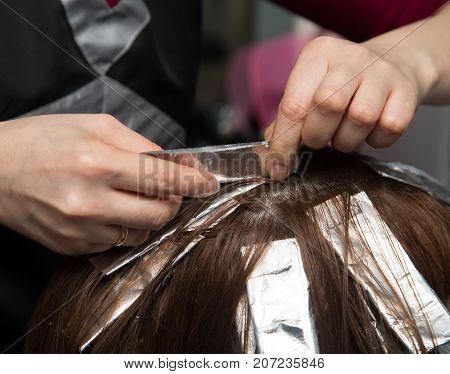 weave hair in salon . Photos in the studio