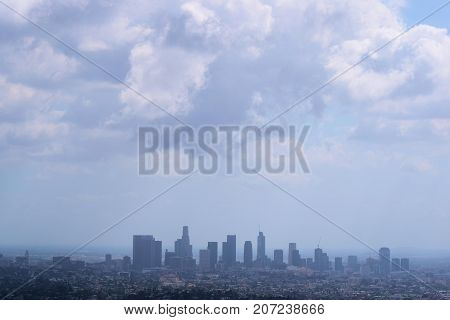 Cumulus clouds above the Downtown Los Angeles, CA Skyline taken from Griffith Park in Los Angeles, CA