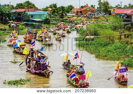 Ayuthaya Thailand - July 11 2014: Buddhists do candle festival parade by boat at Ladchado canal in Ayuthaya Thailand