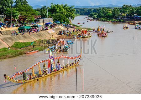 Nan, Thailand - October 25, 2014: Thai traditional long boat racing, usually held on year end after river full of water, on Nan river of Nan, Thailand