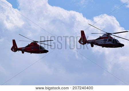 October 3, 2017 in Los Angeles, CA:  Pair of Coast Guard Helicopters conducting a search and recue mission for injured hikers in Griffith Park taken in the skies above Los Angeles, CA and are often the first responders for stranded and injured people