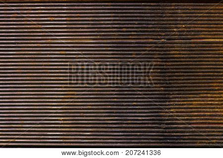 The metal grooved surface texture with rust