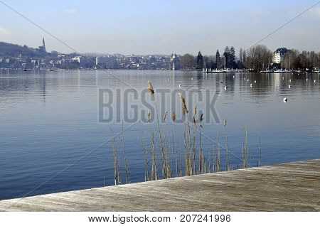 Annecy lake and view of city from walking wood pontoon Savoy, France
