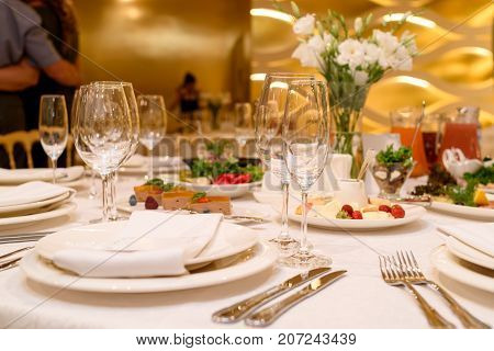 Sparkling Glassware Stands On Round Table Prepared For Wedding Dinner In Restaurant. Table Setting,