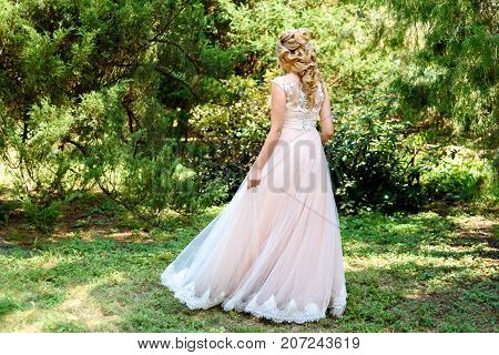 Beautiful Bride In Wedding Dress Spinning In The Park Outdoor. Dress Developing In Wind. Happy Bride