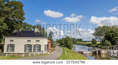 Panorama of an old house at the river in Groningen Netherlands