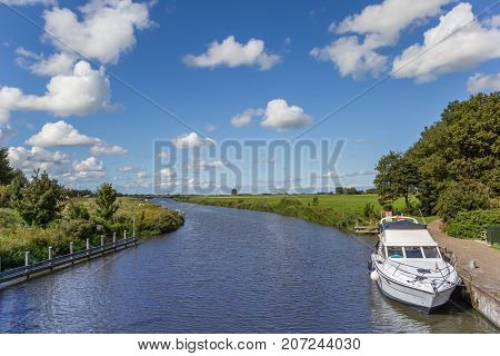White yacht in the Reitdiep river in Groningen Netherlands