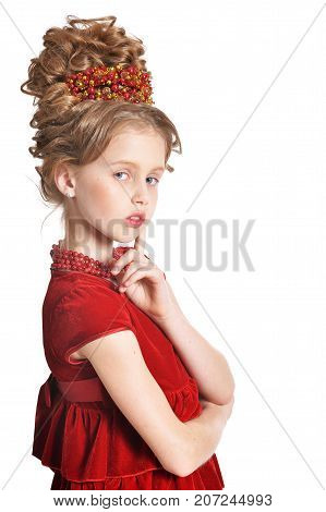 Cute little girl in red velvet dress with retro hairstyle isolated on white background