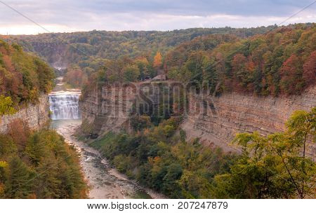 Inspiration Point in early Autumn at dusk is the sight of beautiful Waterfalls and train trestle at Letchworth State Park, NY
