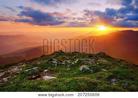 Amazing mountain landscape with colorful vivid sunset on the cloudy sky, natural outdoor travel background. Beauty world.