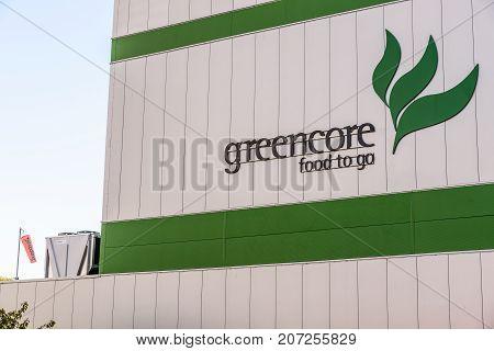 Northampton UK October 3 2017: Greencore Food Group logo sign on factory wall Northampton.