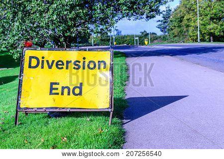 Diversion end sign on pedestrian footpath uk road.