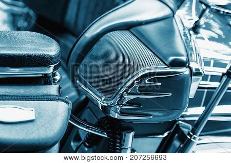 Detail of luxury motorbike speaker. Blue colored.