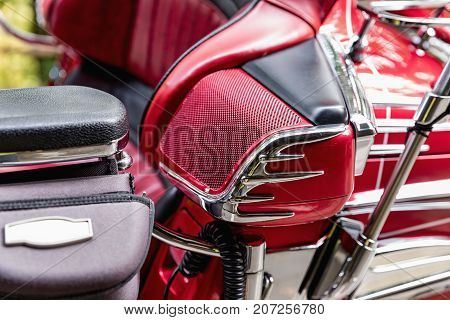Detail of red luxury motorbike speaker. Front view