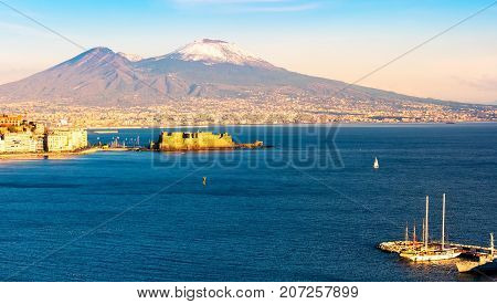 Panoramic aerial view of Naples with the unusually snowy Vesuvius volcano. Campania, southern Italy