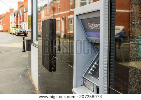Northampton Uk October 3, 2017: Natwest Bank Atm Closed Down With Wooden Board Northampton