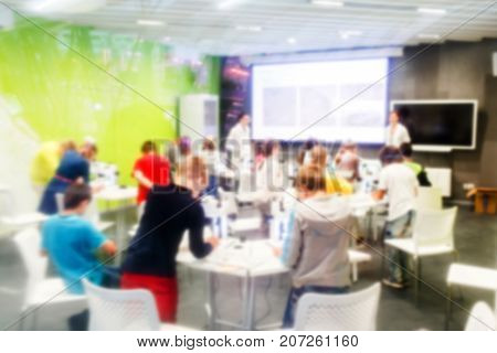 Defocused picture of schoolchildren in chemical class on lesson