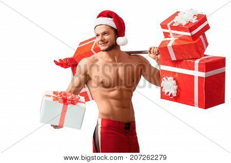 2018, 2019. Your personal fitness instructor. Young athletic toned and fit guy showing off his hot muscular body smiling widely with a gift in his hand