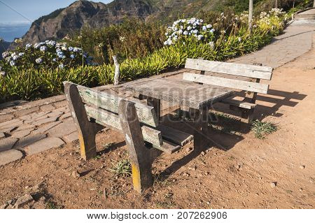 Two Outdoor Benches And Table In Mountains