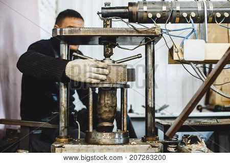 The Worker Works On The Machine. Press For Rubber Penis.