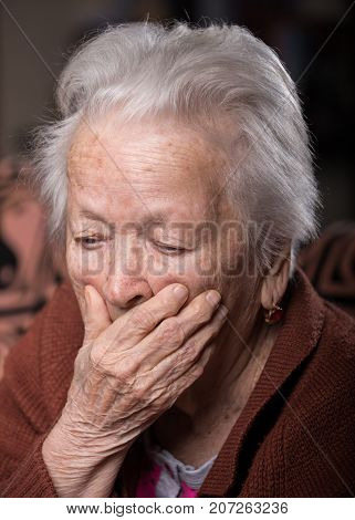 Portrait Of Old Gray-haired Sad Woman