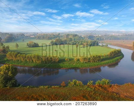 a beautiful countryside aereal view with autumn colour