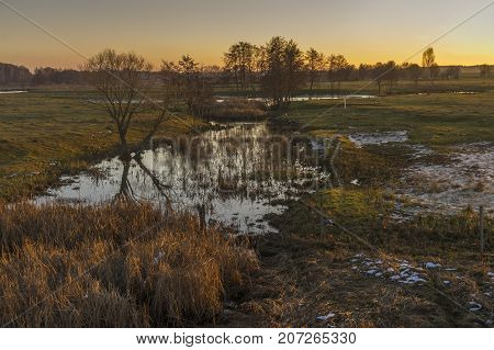 Pictorial evening landscape with Syrovatka river at sunset time Sumskaya oblast Ukraine