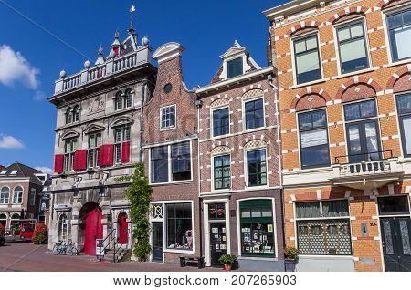 HAARLEM, NETHERLANDS - SEPTEMBER 03, 2017: Weigh house and shops in the center of Haarlem Netherlands