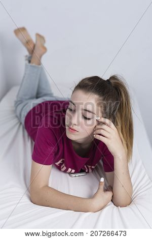 15-year-old Adolescent Lying On Her Bed