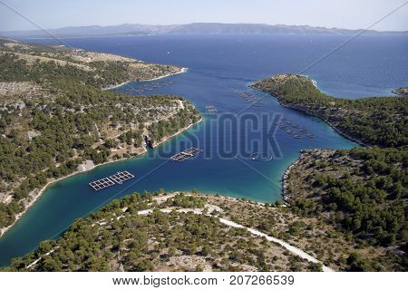 Round and square cages for fish farming in bay on south of island Brac in Croatia