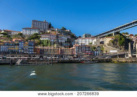 Old Town Skyline from Across the Douro River: Typical Colorful Facades and Rabelo Boats - Porto Portugal